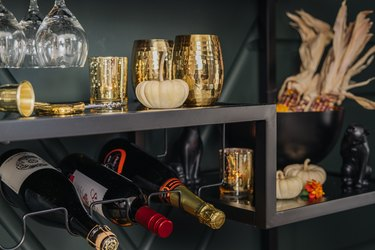 Bar cart with gold hammered goblets, wine rack and pumpkin, corn decor