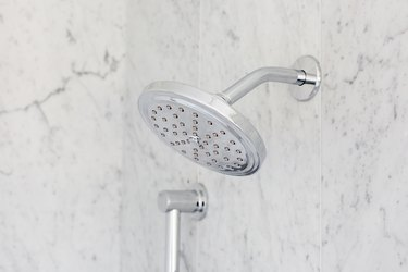 Showerhead in marble shower