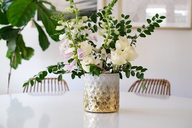 Textured white and gold vase with gold and pink flowers