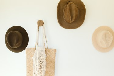 vintage hats hanging on a wall