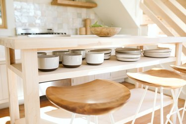 flatware and wooden bar stools with wooden kitchen island