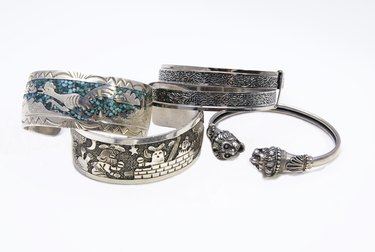 Over-cleaning sterling silver with lemon juice can remove oxidation the artist intended.