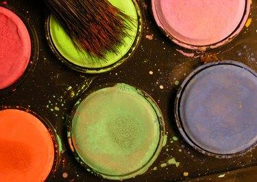 Paintbrush on paint palette