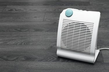 white electric heater on the floor