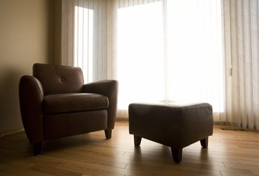 Living room with armchair and ottoman