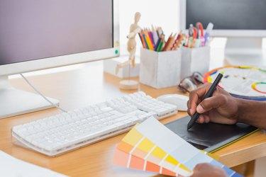 Designer using a graphics tablet