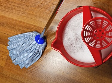 mop and bucket with water for cleaning floors
