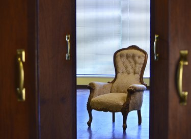 Victorian style chair framed by doorways