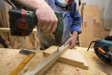 working carpenter with drill.