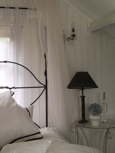 Wrought iron bed and bedside table