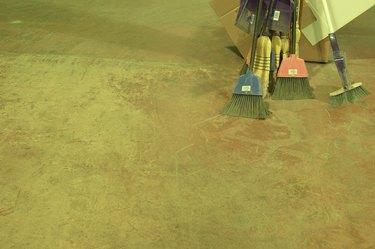 Brooms on concrete floor