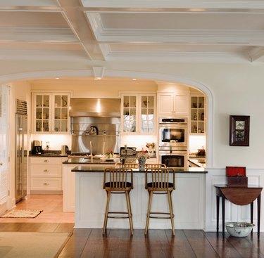 Kitchen with bar stools at counter