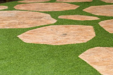 Pathway of stone bricks on grass