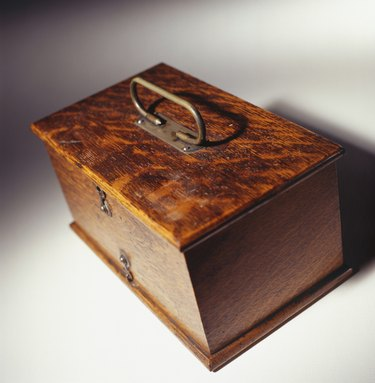 Polished antique wooden oak  box with brass handle