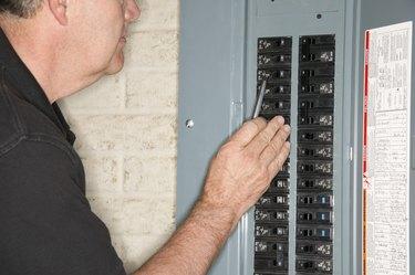 Man checking fuse box