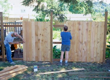 Carpenters Building a Fence