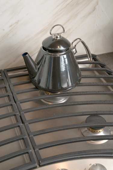 Tea kettle on contemporary gas stove