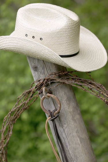 Cowboy hat and lasso on post