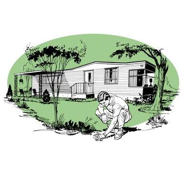 Man weeding near mobile home