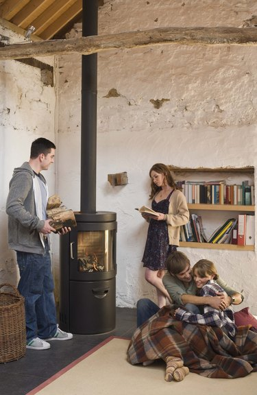 Friends around wood stove indoors