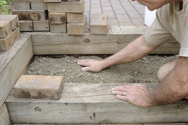 Worker Installing Brick Steps