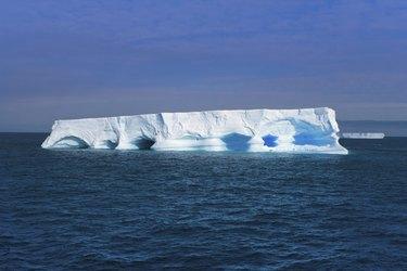Flat iceberg floating at Antarctic Peninsula