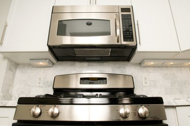 Steel oven with microwave in kitchen