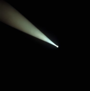 Beam of spotlight in darkness
