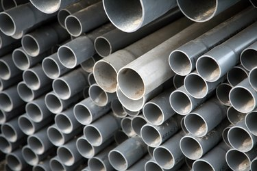 Stack of PVC pipe at construction site