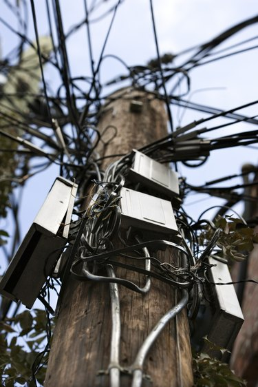 Utility pole with cables and boxes