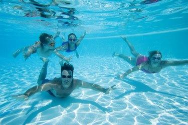 Family swimming underwater