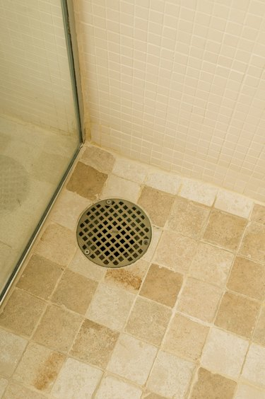Drain in shower on tile floor