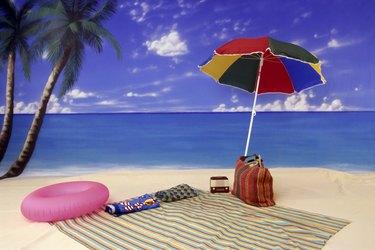 Umbrella and blanket on beach