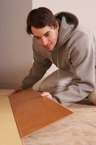 Man installing flooring