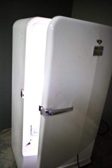 Refrigerator with open door