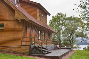 country wooden house close to lake