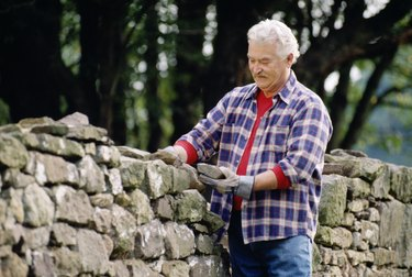 Man building rock fence