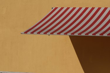 Striped awning on wall
