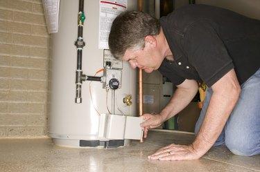 Man checking water heater