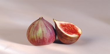 Cross-section of fig by whole fig, close-up