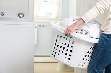 Cropped shot of woman carrying laundry basket