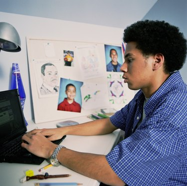 Teenage Boy Working on Homework