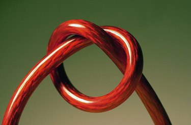Red cord tied in a knot