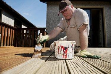 Man painting decking