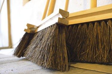 large brooms on wooden floor housework
