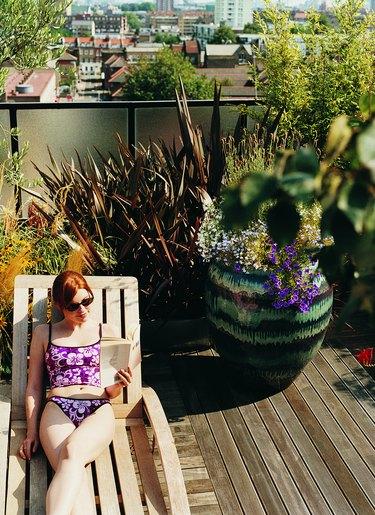 Woman Sunbathing in Her Roof Garden