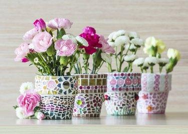 Carnation in mosaic flower pot