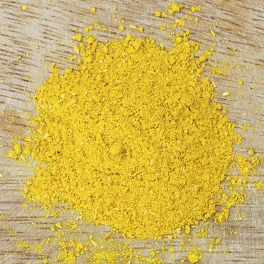 Curry powder on wooden board
