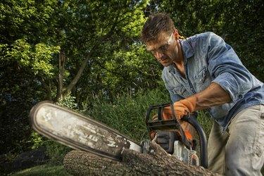 Man sawing a log