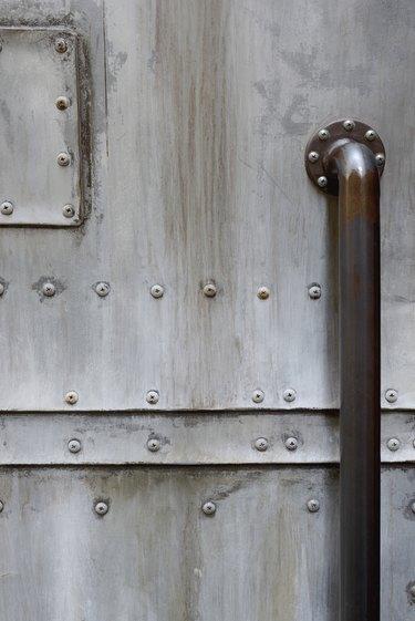 grunge metal door with door handle